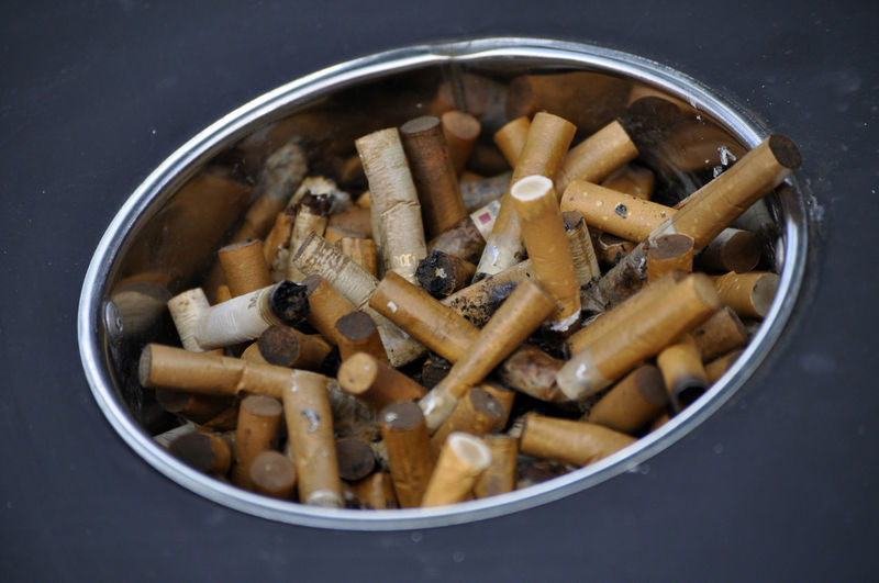 Discarded cigarette butts in ashtray in hotel in Noumea, New Caledonia. Addiction Air Pollution Ashtrays Butts Cigarette Butts Cigarettes Close-up Discarded Filter Tips Habits Health Hospitality Hotels Lifestyle Lung Cancer New Caledonia Noumea Smoking Society Table