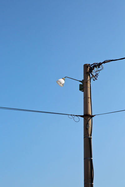 Sky Blue Lighting Equipment Electricity  Clear Sky Street Light Low Angle View Cable Copy Space Technology No People Power Line  Light Connection Day Pole Fuel And Power Generation Light Bulb Outdoors Power Supply Telephone Line Electric Lamp Electrical Equipment Funny Public
