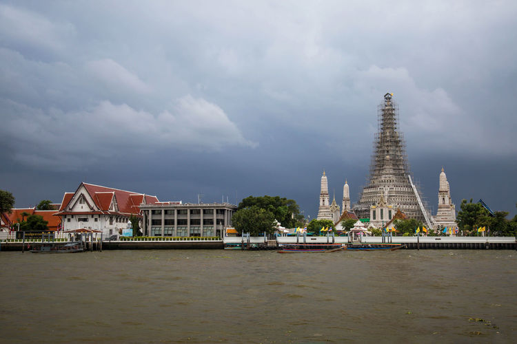 Architectural Feature Architecture Building Exterior Built Structure City Cloud - Sky Cloudy Day Outdoors Renovation River Sky Thailand Tourist Attraction  Traveling Wat Arun Water Waterfront