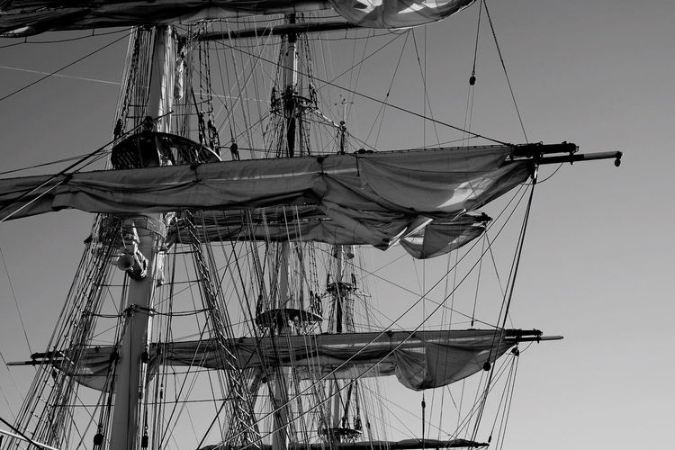 Low Angle View Of Sailing Ship Canvas And Mast Against Sky