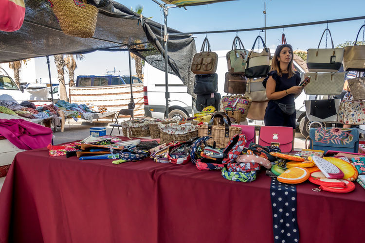 Real People One Person Day Front View Young Adult Market Market Stall Lifestyles Incidental People Casual Clothing Smiling Retail  Young Women Women Fashion Outdoors Large Group Of Objects Leisure Activity Nature Sale Almería SPAIN Market Street Market