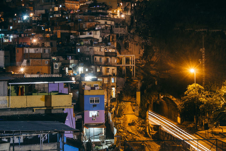 High angle view of illuminated houses at night