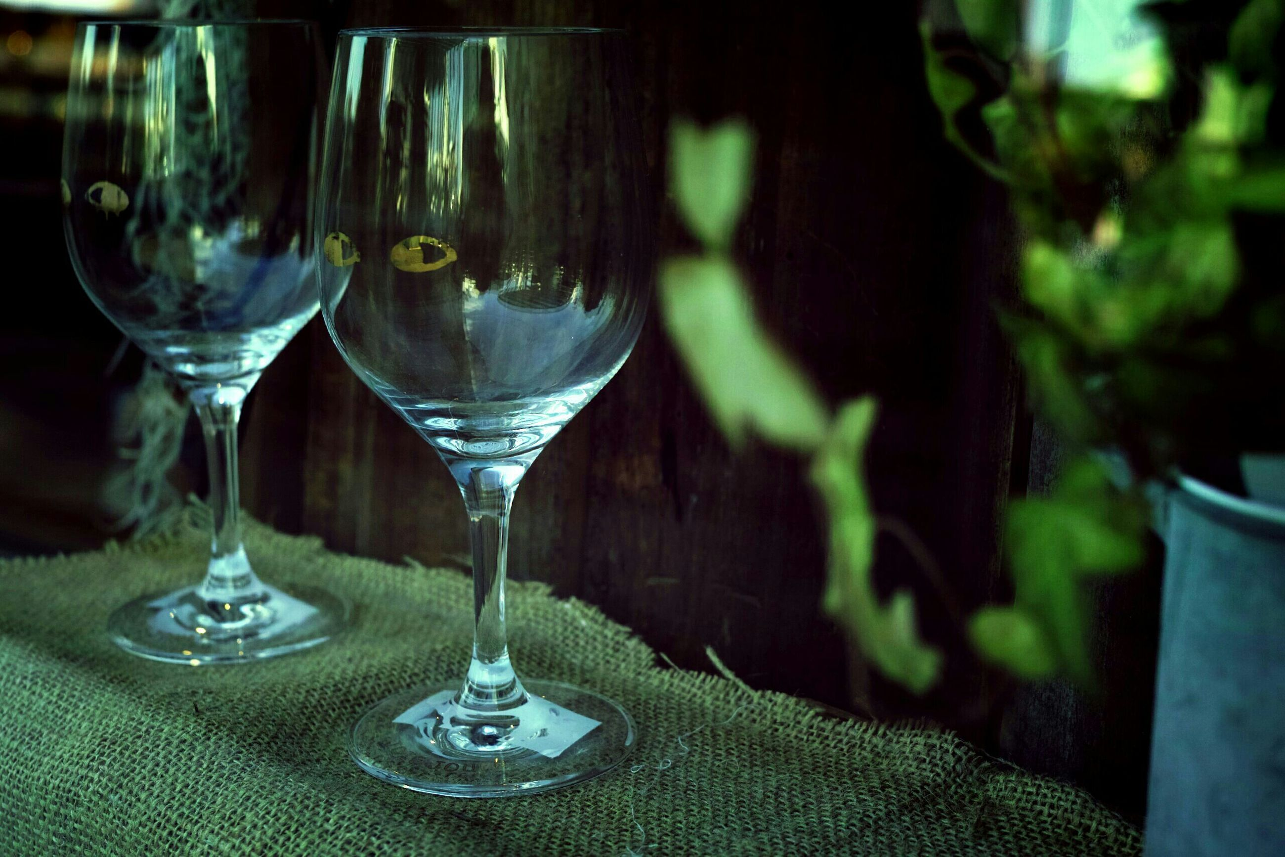 indoors, glass - material, drinking glass, table, wineglass, transparent, close-up, still life, focus on foreground, drink, food and drink, refreshment, glass, wine, alcohol, restaurant, water, bottle, freshness, no people