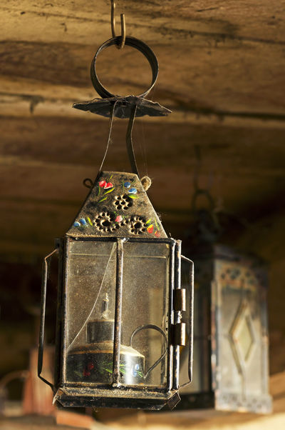 antique vintage candle lanterns in old mud house Antique Atmosphere Light Candlelight Close-up Darkness And Light Decorative Lights Focus On Foreground House Lamp Lamps Metallic Night Lights No People Old Still Life Time Vintage Wooden Texture