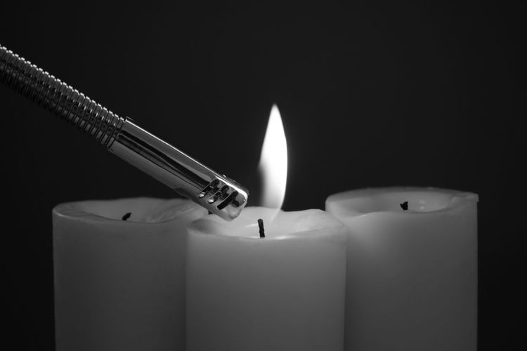 Black Background Burning Candle Close-up Copy Space Dark Fire Flame Indoors  Lighter No People Studio Shot Wax