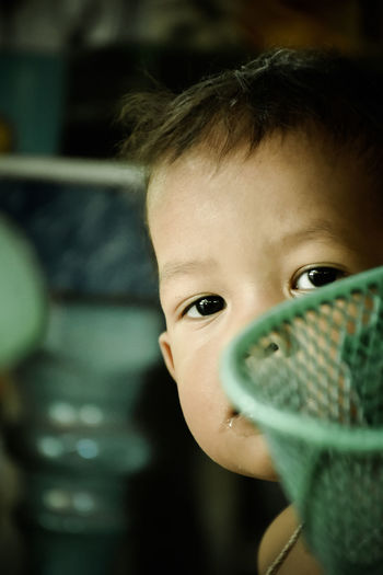 Child Portrait One Person Childhood Headshot Looking At Camera Close-up Real People Lifestyles Focus On Foreground Offspring Leisure Activity Indoors  Cute Males  Boys Holding Human Face Innocence Drinking Teenager