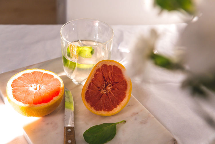 Citrus Fruit Close-up Cross Section Drink Drinking Glass Food Food And Drink Freshness Fruit Glass Glass - Material Healthy Eating Household Equipment Indoors  No People Orange Refreshment SLICE Still Life Table Wellbeing
