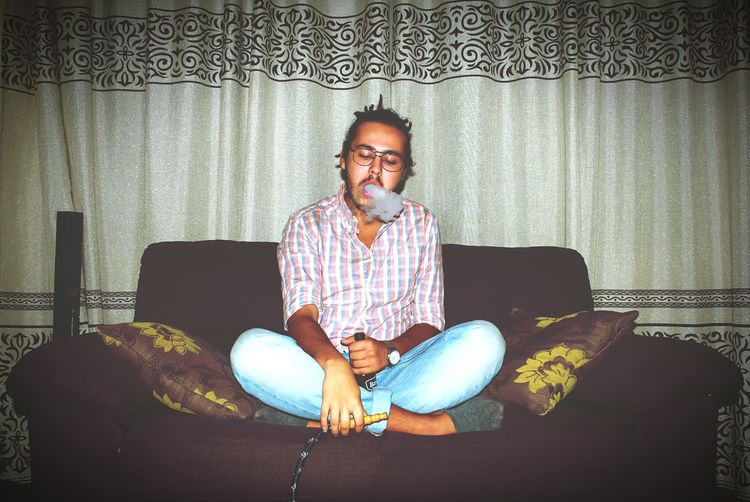 Hookah Chicha Eyeglasses  One Person Front View Adult Living Room Sofa Portrait Indoors  Arts Culture And Entertainment Saidia Oujda Morocco UAE , Dubai Uae,abudhabi UAE Smoke Reflection Summer Photography Tranquility Summer Vibes Summerfeelings