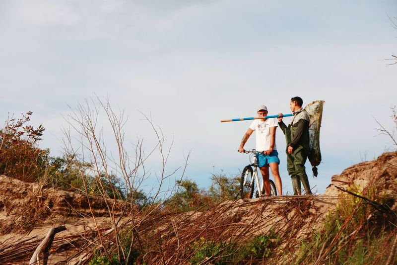 Two People Bicycle People Sky Adult Men Togetherness Lithuanian Nature Lithuanian Colors Lithuania Amber Hunter Amber Nature Horizon Over Land Adventure Two Men Doni After Storm Messy Beach Dunes Baltic Countries Baltic Sea