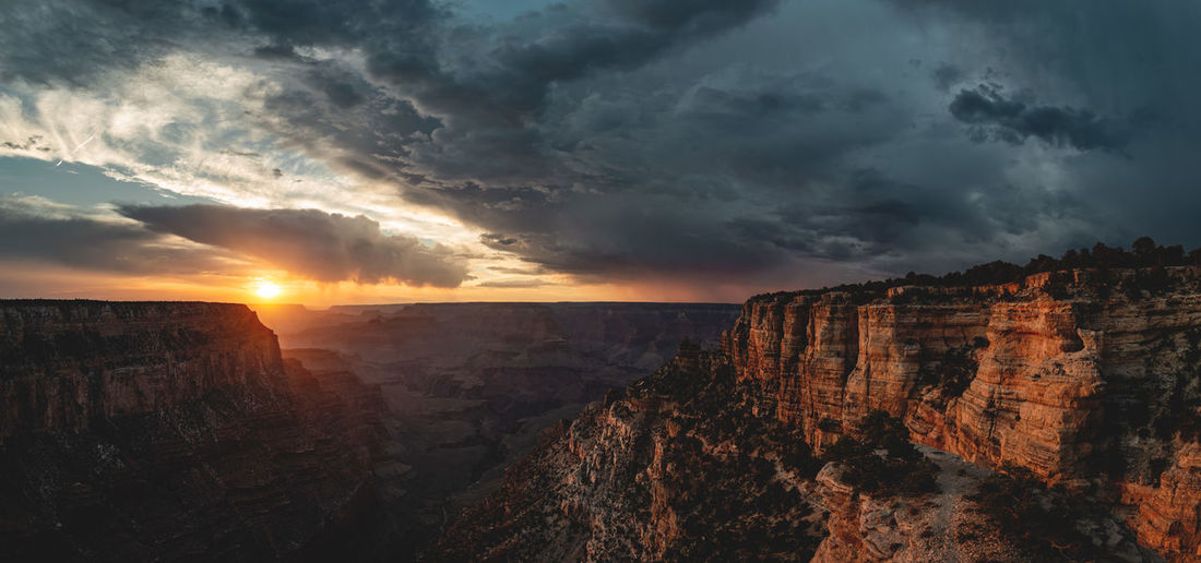 Grand Canyon National Park 🌦🌩⛅️ Panorama shot from the South Rim with a storm approaching from the right just before sunset. Cloud - Sky Eroded Formation Outdoors Travel Mountain Canyon Sunset Nature Non-urban Scene Rock Formation Scenics - Nature Sky Grand Canyon Grand Canyon National Park USA Arizona Travel Destinations Destination Roadtrip Sunlight Landscape Cliff Rim Plateau Against The Light Landmark Iconic Hiking Hiking Adventures Vastness Valley Places Discover  Edge My Best Photo Wide Angle Panorama View Storm Storm Cloud Dramatic Sky High Resolution Wonders Of The World Escarpment Adventure Clouds And Sky Cloudscape Rain End Of Day