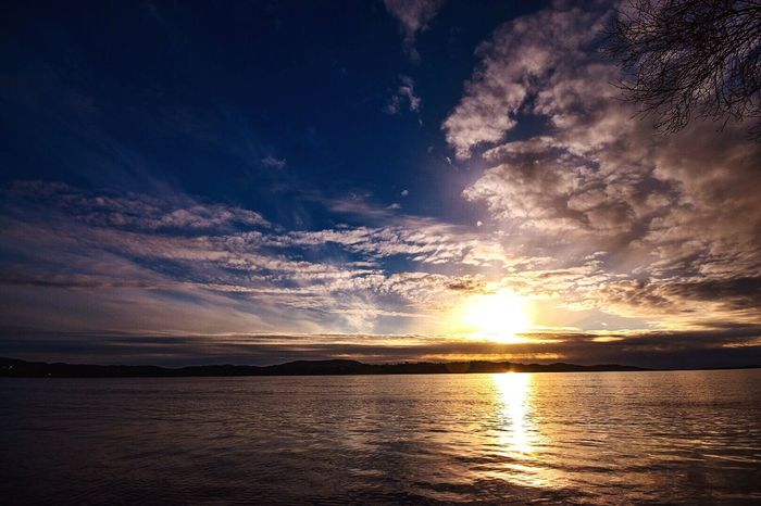 Sunset Scenics Beauty In Nature Reflection Tranquility Nature Sky Tranquil Scene Dramatic Sky Majestic Sea Idyllic No People Water Cloud - Sky Outdoors Landscape Horizon Over Water Day