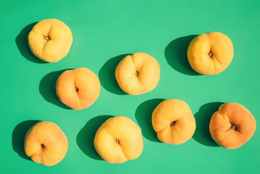 Peach Directly Above Freshness Fruit Green Background Group Of Objects Healthy Eating High Angle View Orange Color Peach