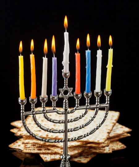 Menorah with lighted candles for Hanukkah on a black in the background. Anniversary Birthday Birthday Cake Birthday Candles Black Background Burning Cake Candle Celebration Chanuka Chanukah Close-up Event Fire Fire - Natural Phenomenon Flame Food And Drink Hanukkah Heat - Temperature Illuminated Indoors  Matzo Matzoth Menorah No People Studio Shot