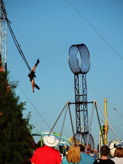 Nebraska State Fair August 2016 Grand Island, Nebraska -- Flippin' - A Steam Punk Theme Aerial & Acrobatic Spectactular Acrobatics  Action Shot  Americans Arts Culture And Entertainment Balancing Act Camera Work Carnival Cultures Daredevil EyeEm Best Shots EyeEm Gallery Eyeemphoto Fairground Flying High Nebraska Performance Performing Arts Photography Photojournalism State Fair Steam Punk Stunts Trapeze Trapeze Artist Upside Down
