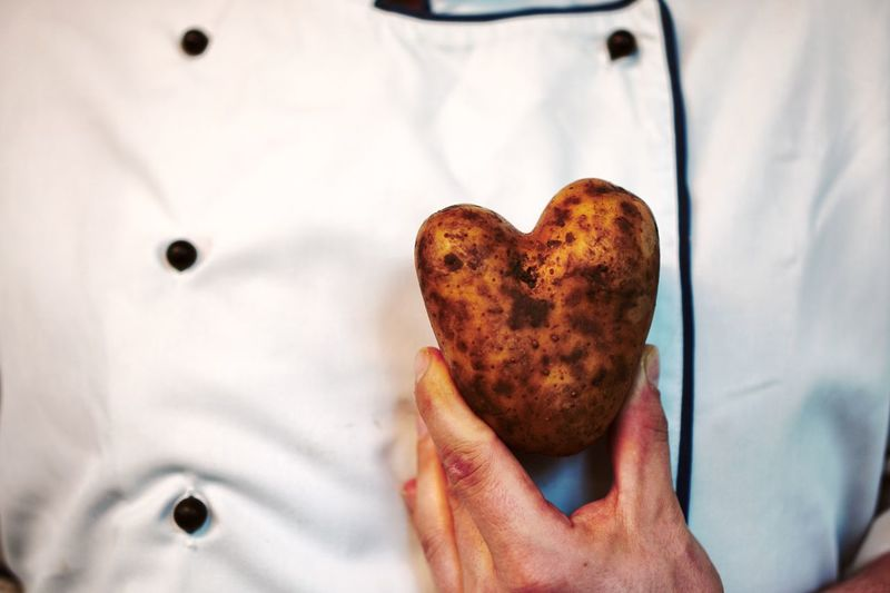 Passion Cook  Fresh Healthy Food Healthy Lifestyle Healthy Eating Heart Potato EyeEm Selects Human Hand Hand Human Body Part One Person Close-up Holding Food And Drink Freshness Midsection Indoors  Food Unrecognizable Person Focus On Foreground White Color Showing Real People Men Adult Heart Shape Finger