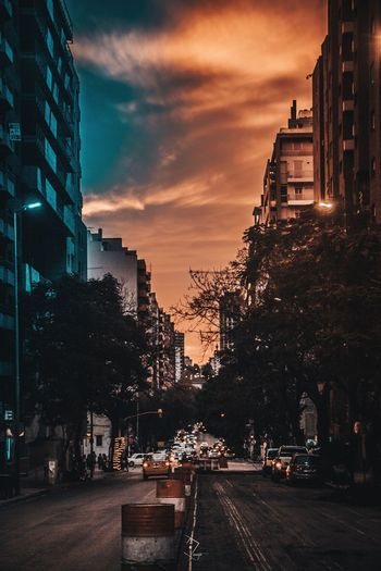 Architecture Skyscraper Sunset City Cloud - Sky Dusk Building Exterior Outdoors Urban Skyline Travel Destinations Night Sky Built Structure Cityscape Red Nightlife Illuminated No People Argentina Photography CanonT6 Canonphotography Argentina EyeEmNewHere EyeEm Selects