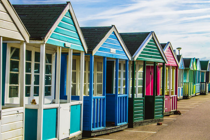 Beach Sand Multi Colored Sea Blue Outdoors Sky Architecture Built Structure Vacations Day Cloud - Sky Travel Destinations Building Exterior Summer No People Pastel Colored Water Southwold Beach Huts Beach Hut Collection