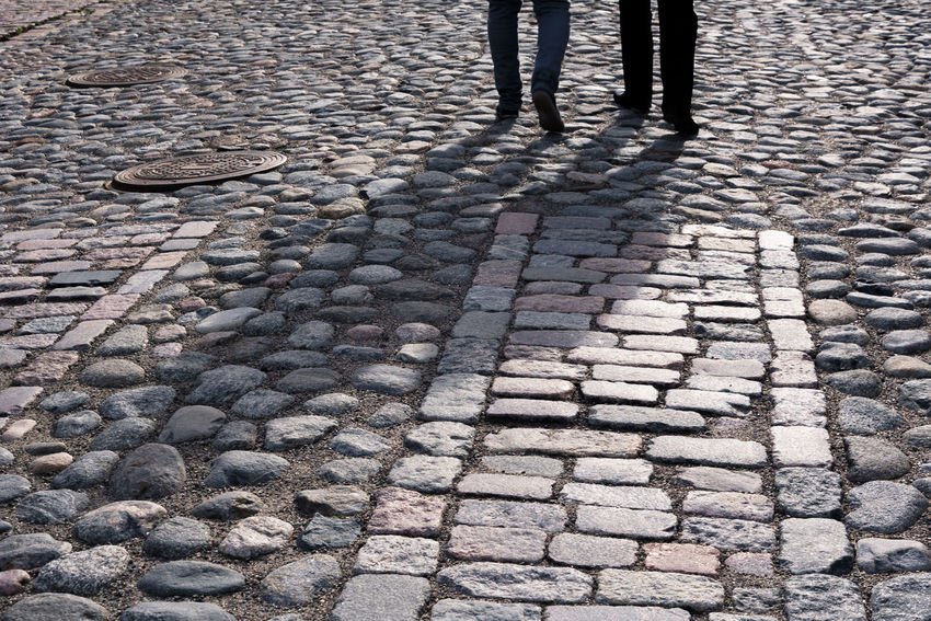 Shadows of friendship. Cobbled Cobblestone Day Friend Friends Friendsforever Friendship Human Leg Long Shadows Manmade Outdoor Outdoors Real People Road Rocks Shadow Shadows Shadows & Lights Stones Strolling Sunlight Sunny Day Walk Walking Walking Around The City