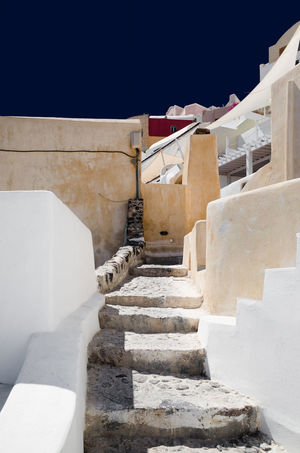 Oia Santorini Santorini, Greece Ancient Civilization Architecture Building Building Exterior Built Structure Clear Sky Day Direction History Nature No People Outdoors Sky Staircase Steps And Staircases Sunlight The Past The Way Forward Travel Destinations Wall - Building Feature White Color