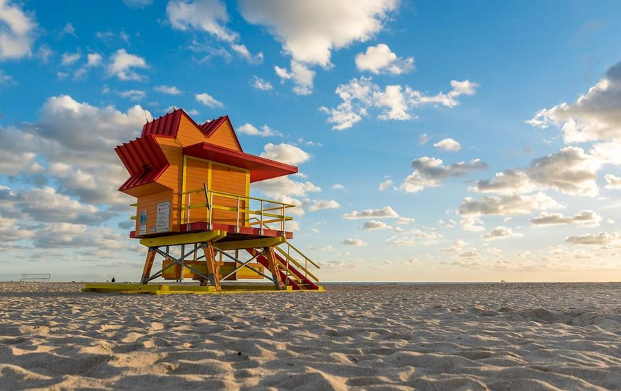 Beach Sand Sea Vacations Sky Scenics Cloud - Sky Travel Destinations Tranquility Beauty In Nature Summer Outdoors Nature No People Tranquil Scene Sunset Day Horizon Over Water Lifeguard Hut Water Miami Beach Holiday