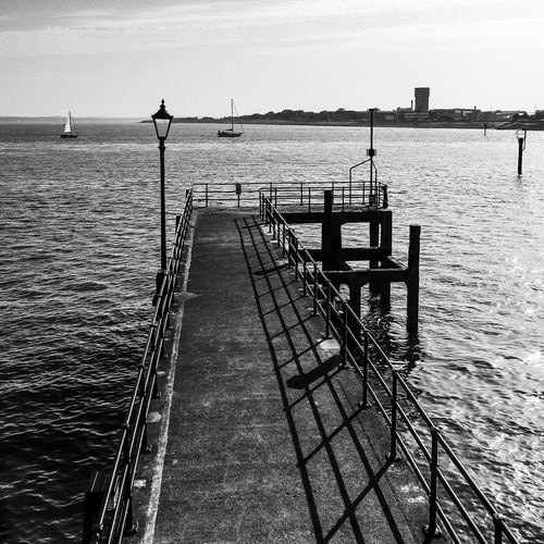 Water Sky Sea Nature Day Scenics - Nature No People Tranquility Sunlight Railing Shadow Pier Horizon Beauty In Nature Tranquil Scene Built Structure Horizon Over Water Outdoors Architecture Promenade