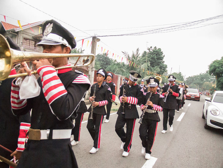 Sticking it up to traffic Marching Band Quick Shot Parade Tanauan Philippines A Glimpse Of Sound Traffic EyeEmNewHere Olympus E-P3 Break The Mold The Photojournalist - 2017 EyeEm Awards