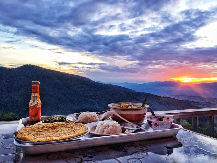 Dinner and sunset Cloudy Sky Sunset Dinner Time Cloud - Sky Sky Food And Drink No People Nature Sunset Food Freshness Container Scenics - Nature Orange Color Beauty In Nature Plate Table