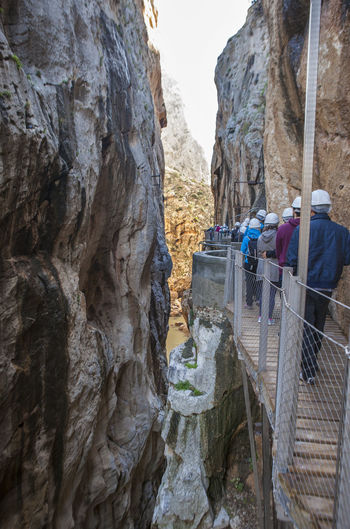 Visitors walking along the footbridge of Caminito del Rey path, Malaga, Spain Beauty In Nature Day Flag Mountain Nature No People Outdoors Rock - Object Scenics Sky Tranquility Travel Destinations Vacations