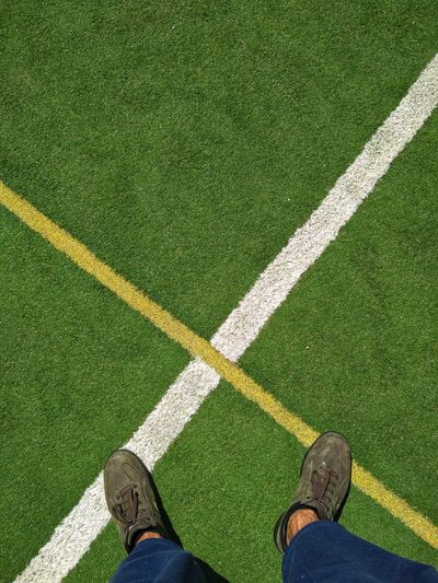 EyeEm Best Shots EyeEmNewHere EyeEm Gallery Tadaa Community Low Section Soccer Field Men Standing Human Leg Sport High Angle View Personal Perspective Grass Green Color Human Foot Shoe