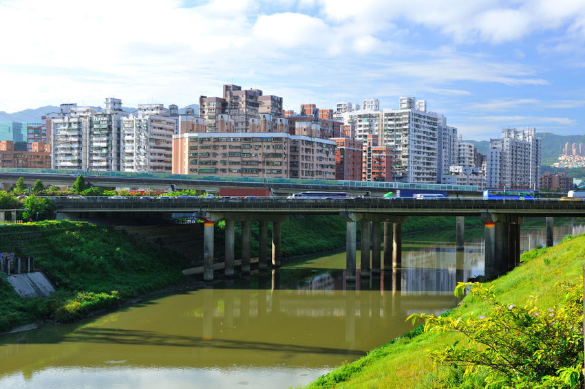River beautiful landscape, fresh natural environment, the city leisure place Keelung River Natural Scenes Taiwan Architecture Bridge Bridge - Man Made Structure Building Exterior Built Structure City Cloud - Sky Connection Day Modern Nature New Taipei City No People Outdoors River Sky Tree Water Xizhi