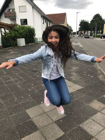 Casual Clothing Built Structure Architecture One Person Front View Smiling Building Exterior Outdoors Happiness Day Long Hair Full Length Looking At Camera Portrait Real People Leisure Activity Young Women Young Adult Childhood Tree Flying Child Girls Sommergefühle