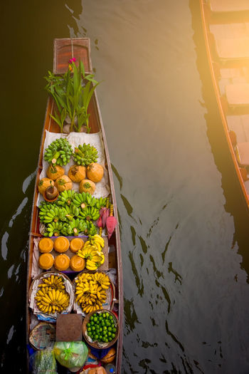 High angle view of food in boat on water