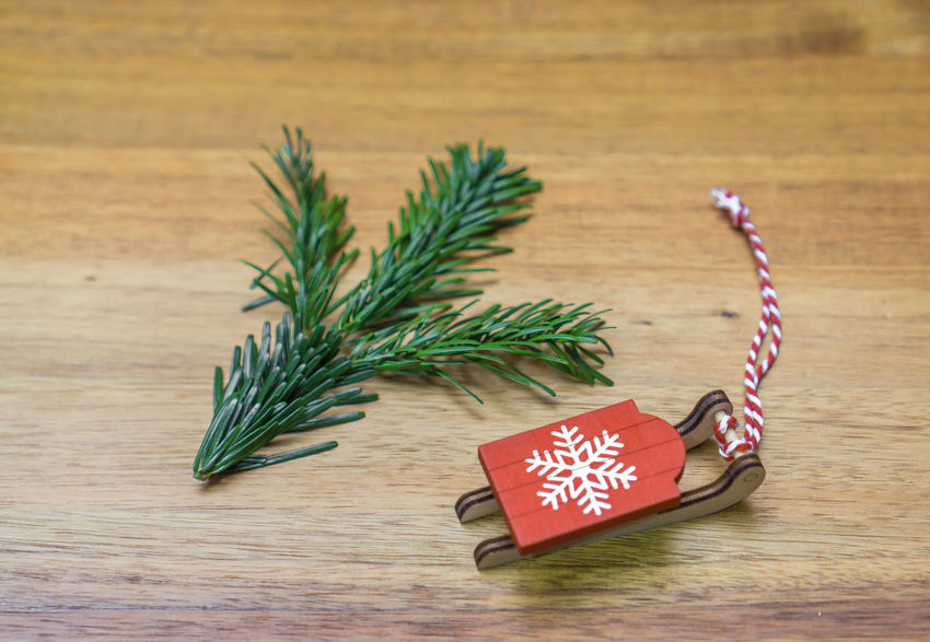 Christmas Copy Space Fir Tree Fir Branch Pine Sledge Sleigh Celebration Christmas Christmas Card Christmas Decoration Christmas Ornament Christmas Tree Close-up Day Decoration Indoors  No People Still Life Table Wood - Material Wooden Background