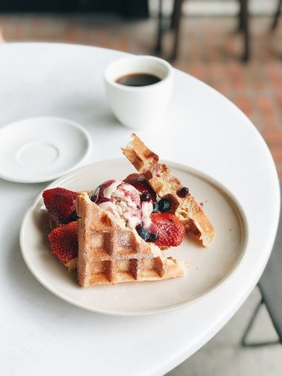 Waffles Plate Food And Drink Sweet Food Freshness Table Ready-to-eat Food Still Life Indoors  Serving Size Dessert Indulgence Coffee Cup Sweet Close-up Drink Coffee Cup No People High Angle View