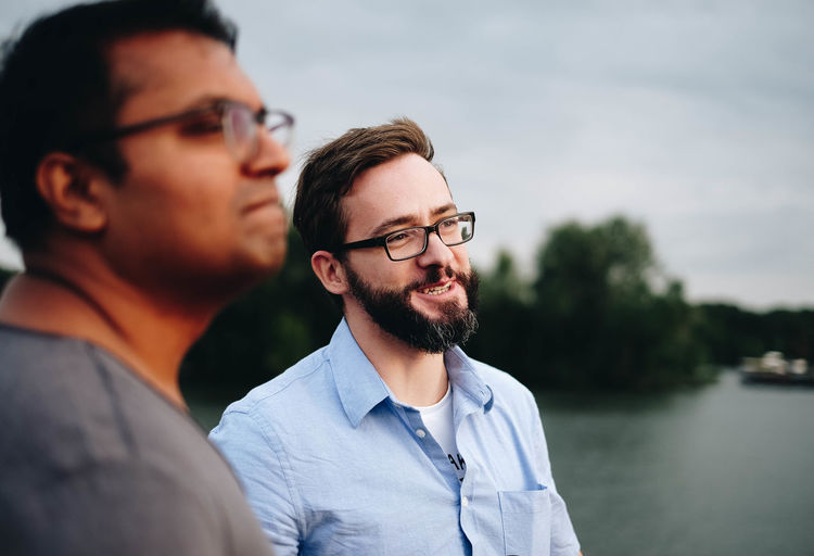 EyeEmOnABoat Adult Beard Bonding Couple - Relationship Eyeglasses  Focus On Foreground Front View Glasses Headshot Lifestyles Nature Outdoors Portrait Real People Smiling Togetherness Two People Water Young Adult Young Men The Modern Professional