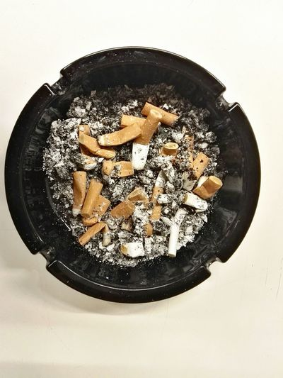 Full ashtray Directly Above White Background Ashtray  Black Ashtray Full Ashtray Cigarettes Kill Cigaretts Cigarette Break Cigarette Kill Unhealthy Unhealthy Lifestyle No People Indoors  Day