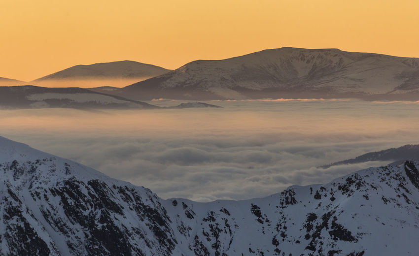 Scenic view of snowcapped mountains against sky during sunset, fagaras mountains