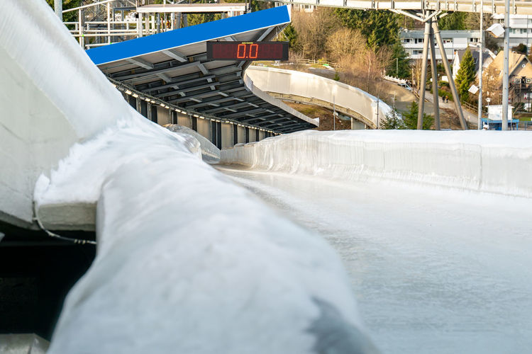 Bobsleigh ice channel in winterberg. the digital clock measures the speed. curvy trail in the ice.