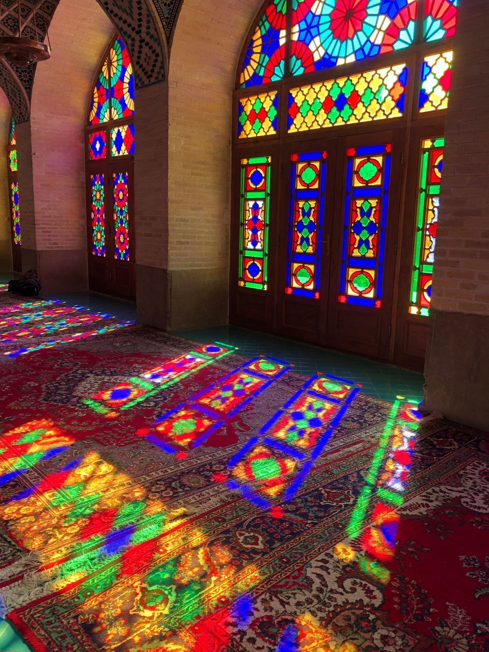 multi colored, art and craft, stained glass, indoors, pattern, creativity, no people, architecture, religion, glass, place of worship, window, belief, built structure, building, carpet - decor, spirituality, design, floral pattern, ornate