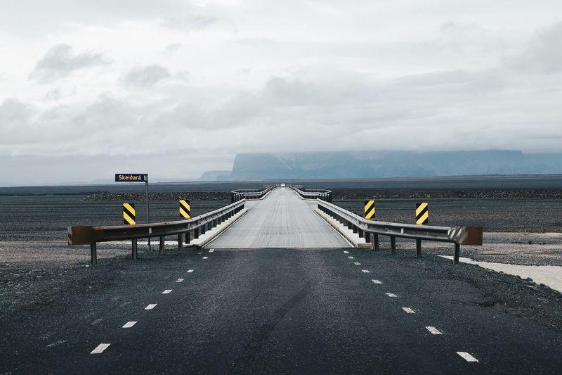Scenic View Of Empty Road In Remote Landscape