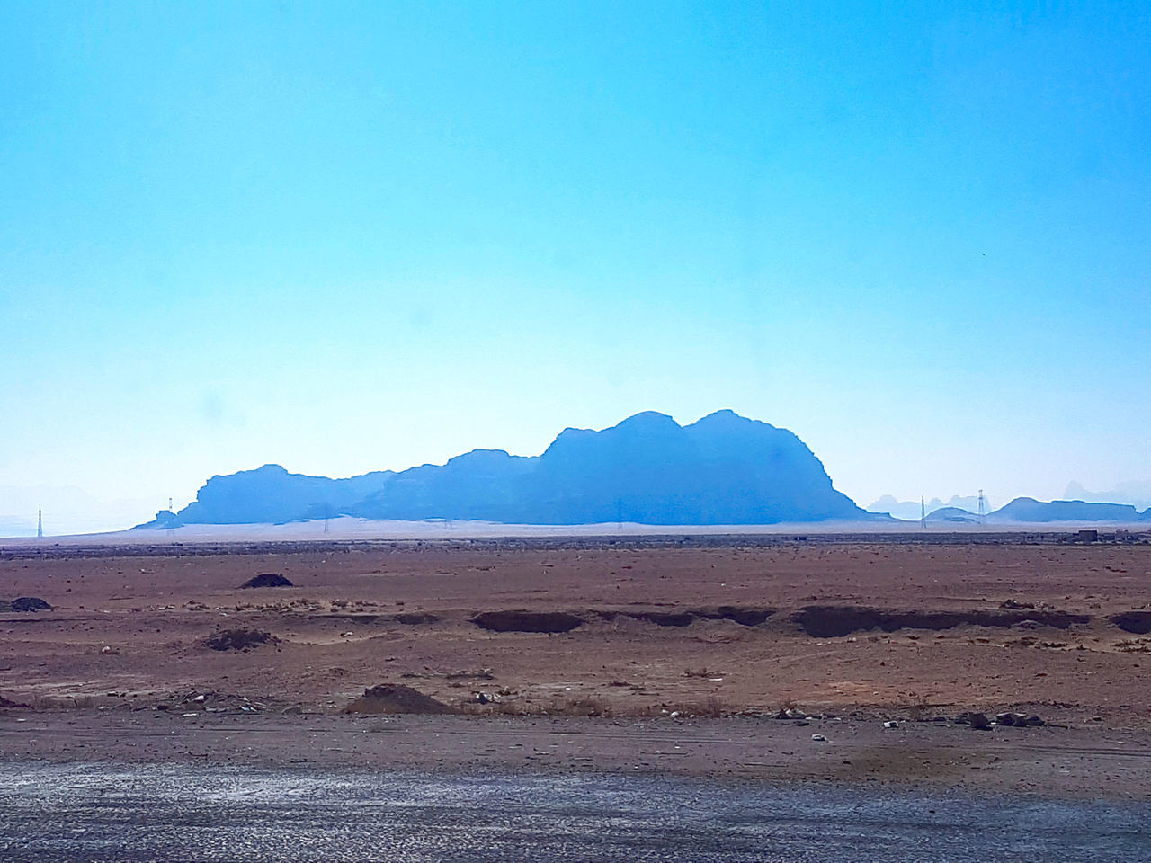 sky, scenics - nature, mountain, tranquil scene, beauty in nature, copy space, non-urban scene, tranquility, landscape, desert, blue, nature, land, clear sky, no people, environment, day, arid climate, remote, climate, mountain range, outdoors, salt flat