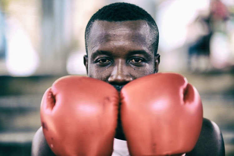 Portrait of man wearing boxing glove