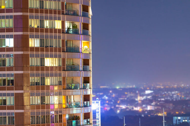 Modern buildings in city at night
