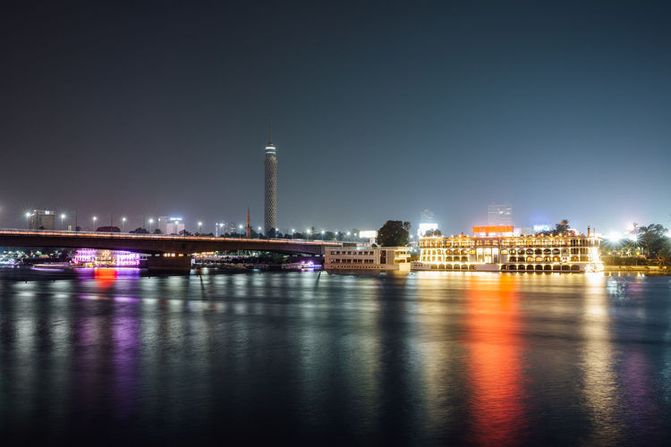 Cairo city center and Nile river at night, long exposure with smoothed out water. Architecture Built Structure Building Exterior Illuminated City Water Night Sky Reflection Travel Destinations River Waterfront Building Bridge Nature Bridge - Man Made Structure Tower Cityscape Outdoors Cairo Egypt Nile River
