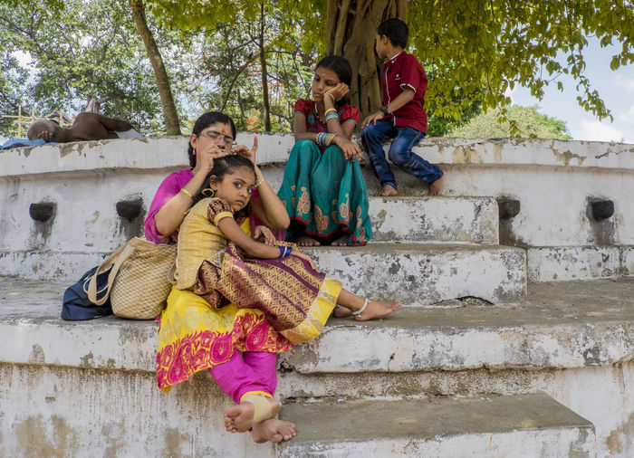 Casual Clothing Children Colors Curious Day Enjoyment Eye Contact Incidental India Outdoors People Person Smiling Street Streetphotography The Street Photographer - 2016 EyeEm Awards Tree