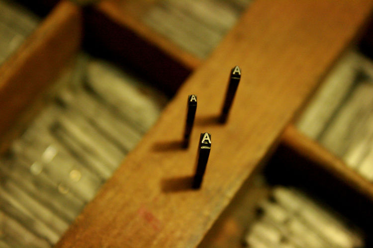 High angle view of letter a on wood at printing press