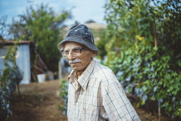 Close-up of senior man standing in garden