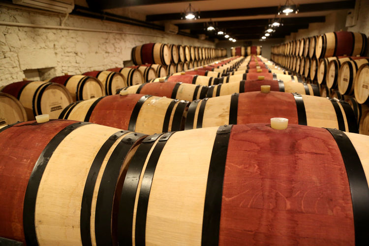 Cellar In A Row Barrel Indoors  Wine Cellar Food And Drink Drink Wine Cask Alcohol Wine Refreshment Large Group Of Objects Winemaking Winery Cylinder Wood - Material Domestic Room Building Architecture Warehouse No People Order