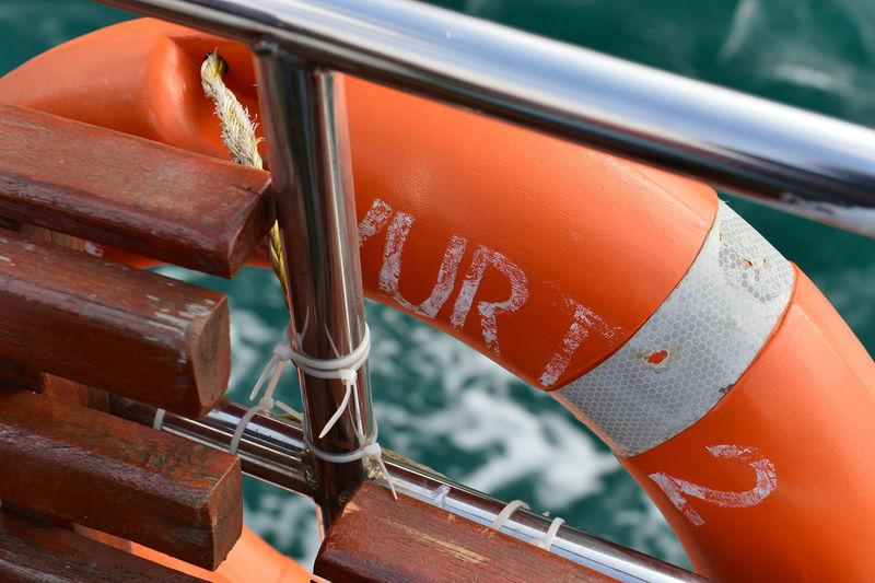 High Angle View Of Life Belt Hanging On Boat Railing