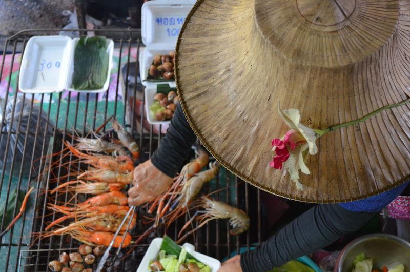 Close-up of man preparing food at market